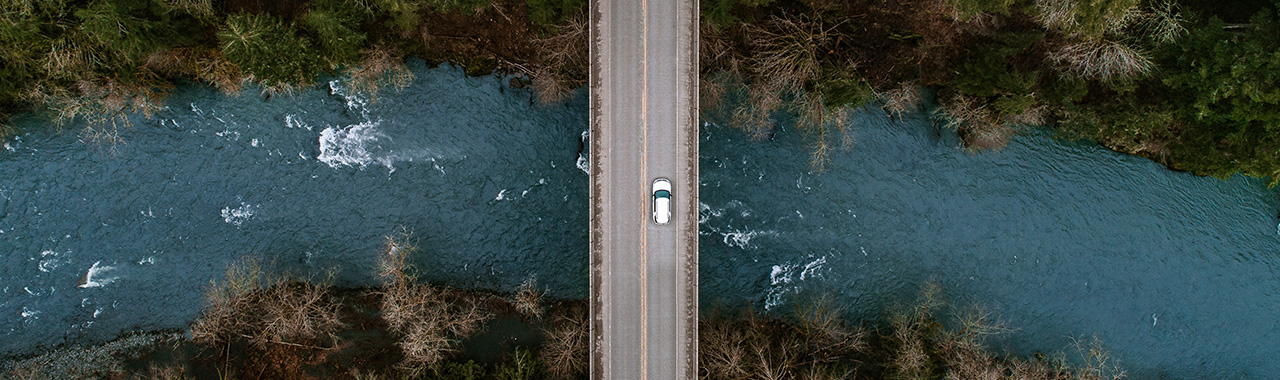 Car driving on road from above